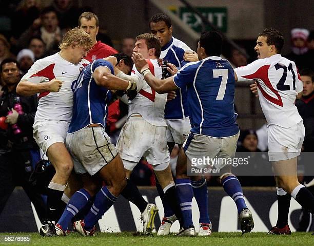 Lewis Moody of England punches Alesana Tuilagi of Samoa during the Investec Challenge match between England and Samoa at Twickenham on November 26...