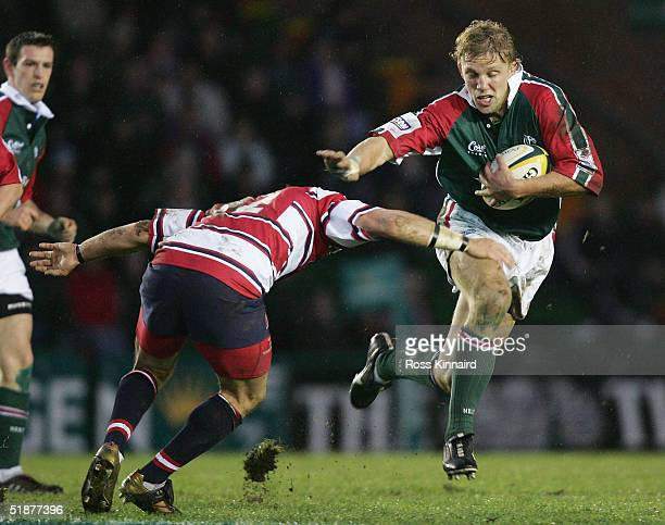 Lewis Moody of Tigers is tacled by Henry Paul of Gloucester during the round six Powergen Cup match between Leicester Tigers and Gloucester at...