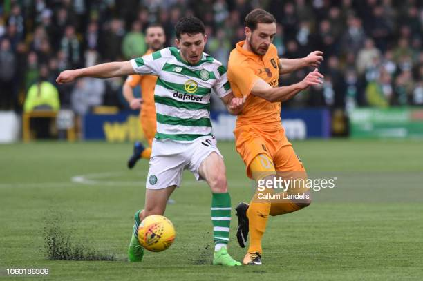 Lewis Morgan of Celtic FC goes shoulder to shoulder with Scott Pittman of Livingston FC during the Ladbrokes Premiership match between Livingston and...