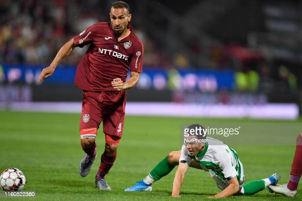 Lewis Morgan of Celtic FC in action against Paulo Vinicius of CFR Cluj during the UEFA Champions League 2019/2020 Third Qualifying Round between CFR...