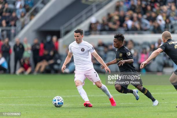 Lewis Morgan of Inter Miami CF and Latin Blessing of LAFC compete for the ball during a game between Inter Miami CF and Los Angeles FC at Banc of...