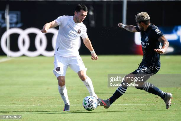 Lewis Morgan of Inter Miami CF and Ronald Matarrita of New York City FC fight for the ball during the first half in the MLS is Back Tournament at...