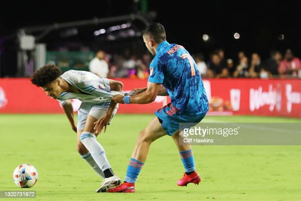 Lewis Morgan of Inter Miami pulls Kevin Paredes of D.C. United away from the ball in the second half at DRV PNK Stadium on May 29, 2021 in Fort...