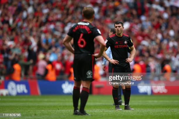 Lewis Morgan of Sunderland and Lee Cattermole of Sunderland look dejected following their sides defeat in the Sky Bet League One Play-off Final match...