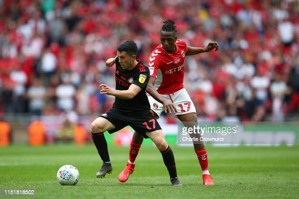 Lewis Morgan of Sunderland battles for possession with Joe Aribo of Charlton Athletic during the Sky Bet League One Play-off Final match between...