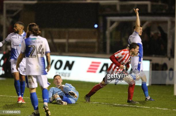 Lewis Morgan of Sunderland hurdles Bristol keeper Sam Slocombe to score the second goal during the Checkatrade Trophy Semi Final between Bristol...