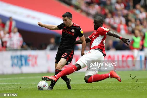 Lewis Morgan of Sunderland in action while challenged by Naby Sarr of Charlton Athletic during the Sky Bet League One Play-off Final match between...