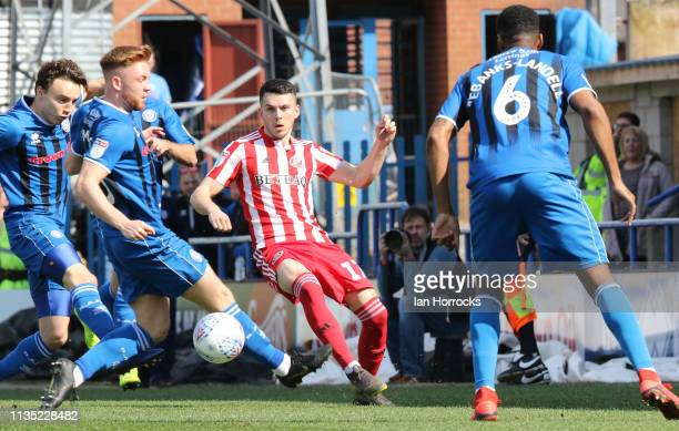 Lewis Morgan of Sunderland passes through the Rochdale players during the Sky Bet League One match between Rochdale and Sunderland at Spotland...