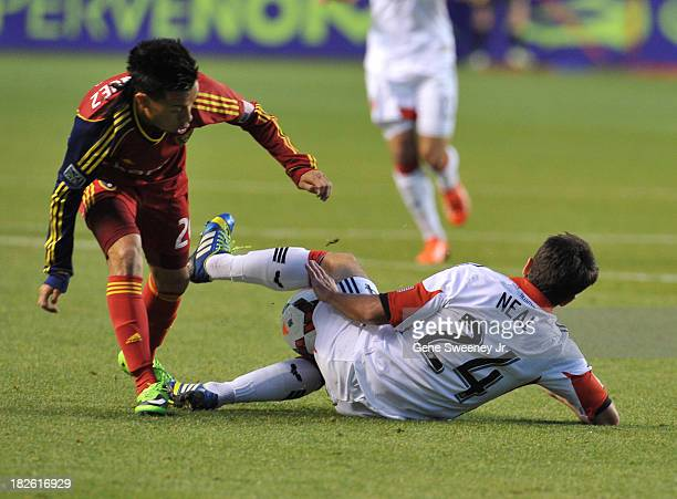 Lewis Neal of DC United tackles the ball away from Sebastian Velasquez of Real Salt Lake at Rio Tinto Stadium October 1 2013 in Sandy Utah