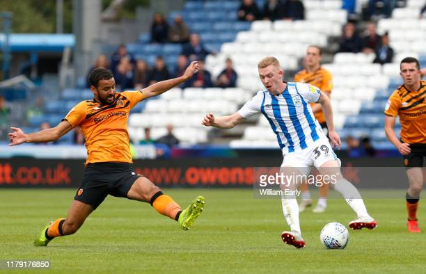 Lewis O'Brien of Huddersfield Town takes on Kevin Stewart of Hull City during the Sky Bet Championship match between Huddersfield Town and Hull City...