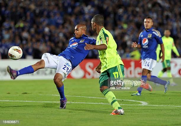 Lewis Ochoa of Millonarios and Tinga of Palmeiras struggle for the ball during a match between Millonarios and Palmeiras as part of the Copa...