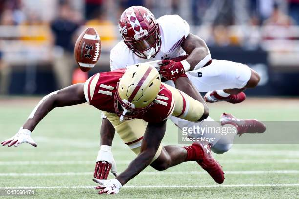 Lewis of the Boston College Eagles is tackled by Chapelle Russell of the Temple Owls during the second half of the game at Alumni Stadium on...