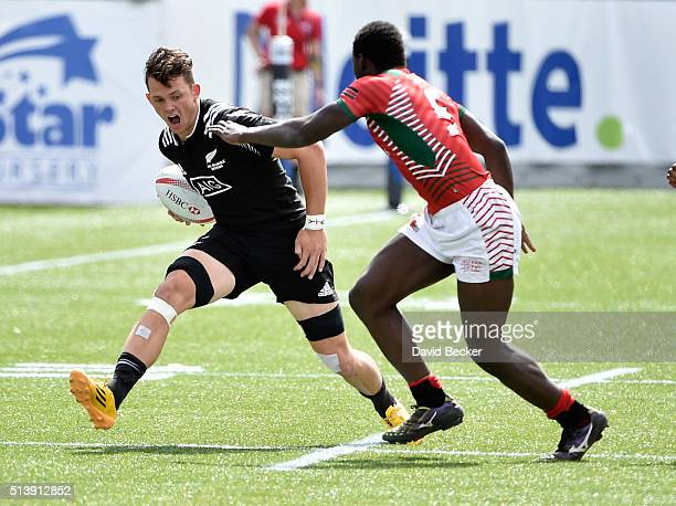 Lewis Ormond of New Zealand carries the ball against Billy Odhiambo of Kenya during the USA Sevens Rugby tournament at Sam Boyd Stadium on March 5...