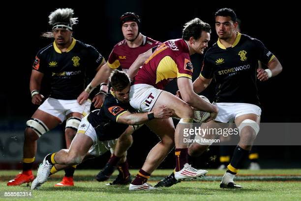Lewis Ormond of Southland is tackled by Wes Goosen of Wellington during the round eight Mitre 10 Cup match between Southland and Wellington at Rugby...