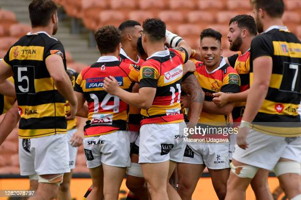 Lewis Ormond of Taranaki celebrates with teammates after scoring a try during the round 7 Mitre 10 Cup match between Waikato and Taranaki at FMG...