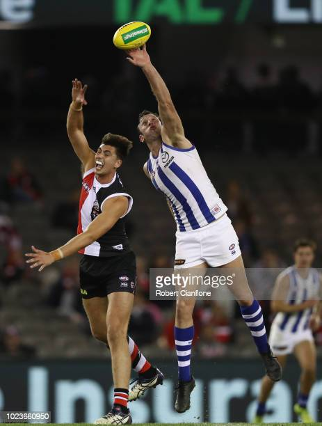 Lewis Pearce of the Saints and Todd Goldstein of the Kangaroos compete for the ball during the round 23 AFL match between the St Kilda Saints and the...