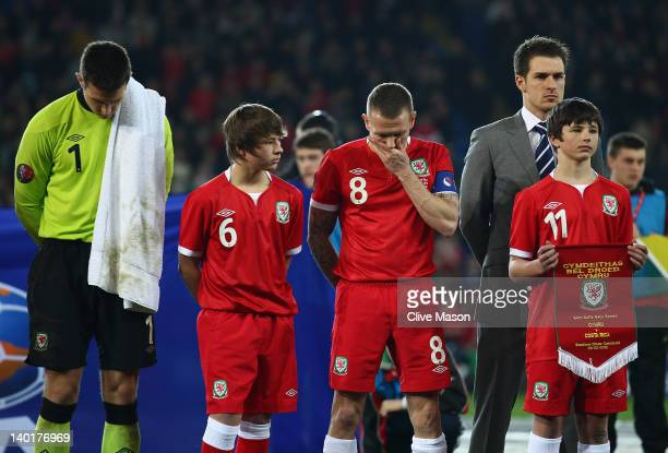 Lewis PriceCraig Bellamy and Aaron Ramsey of Wales are seen with Edward and Thomas Speed during the national anthem during the Gary Speed Memorial...
