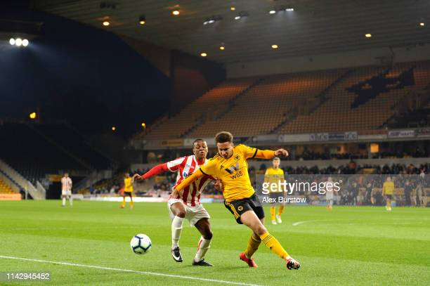 Lewis Richards of Wolverhampton Wanderers battles for possession with Abdoulaye Toure of Stoke City during the Premier League 2 match between...