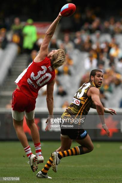 Lewis RobertsThomsom of the Swans spoils in front of Lance Franklin of the Hawks during the round ten AFL match between the Hawthorn Hawks and the...