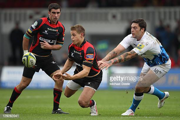 Lewis Robling of Newport Gwent Dragons offloads as Matt Banahan of Bath challenges during the LV Cup match at Rodney Parade on October 15 2011 in...