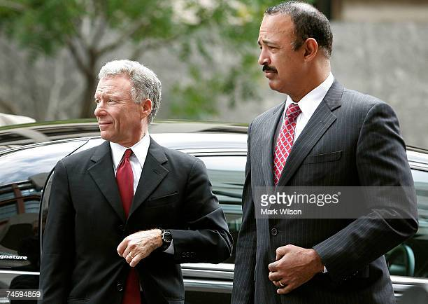 Lewis Scooter Libby and his attorneys Theodore Wells arrive for a hearing at the Federal Court House June 14 2007 in Washington DC Libby is in court...