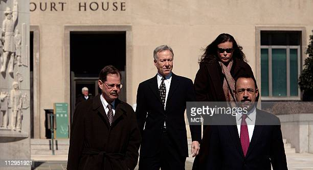 Lewis 'Scooter' Libby and his wife Harriet leave the US Federal Courthouse with lawyers Theodore Wells and William Jeffress Jr in Washington March 6...