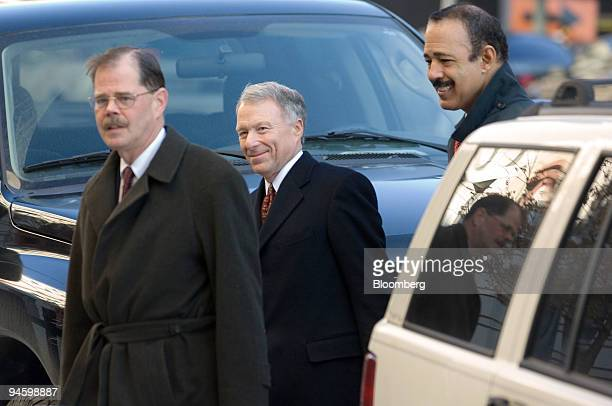 I Lewis Scooter Libby center former chief of staff for Vice President Dick Cheney arrives with attorneys William Jeffress left and Ted Wells right at...