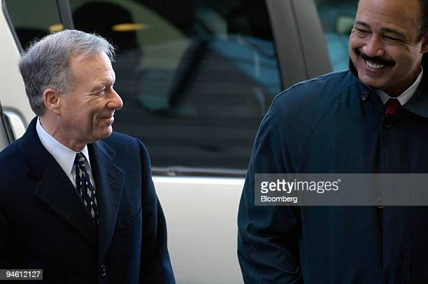 I Lewis Scooter Libby former Chief of Staff for Vice President Dick Cheney left shares a smile with attorney Ted Wells as they arrive at the US...