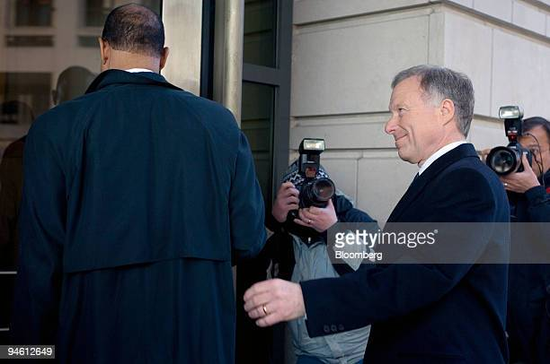 I Lewis Scooter Libby former Chief of Staff for Vice President Dick Cheney right follows his attorney Ted Wells as they enter US District Court for a...
