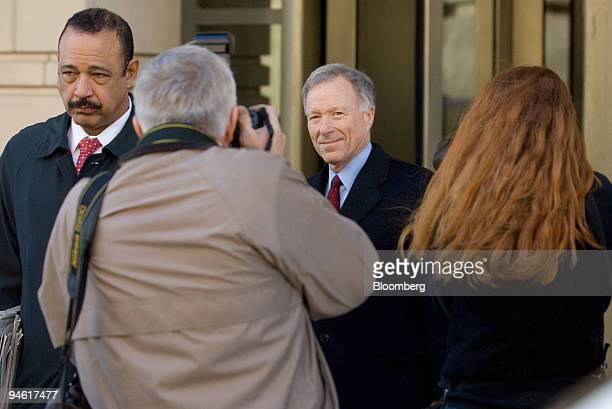 I Lewis Scooter Libby former Chief of Staff for Vice President Dick Cheney right follows attorney Ted Wells left as they leave the US District Court...