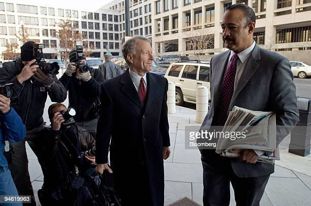 I Lewis Scooter Libby former Chief of Staff for Vice President Dick Cheney second from right pauses with attorney Ted Wells right as they arrive at...