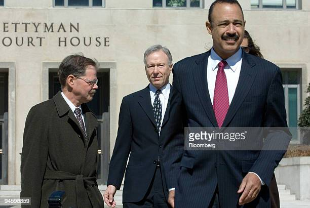 Lewis Scooter Libby former chief of staff to Vice President Dick Cheney center is accompanied by defense lawyers William Jeffress left and Ted Wells...