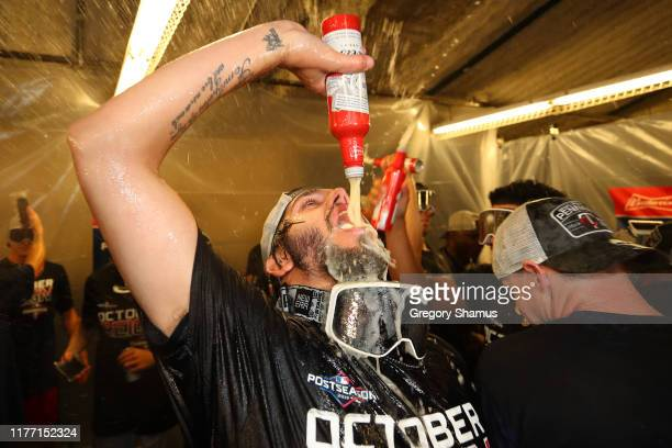 Lewis Thorpe of the Minnesota Twins celebrates winning the American League Central Division title after a 51 win against the Detroit Tigers and a...