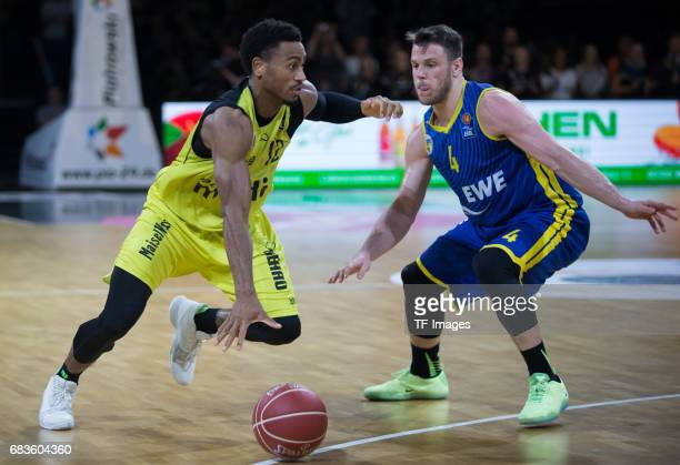 Lewis Trey of medi bayreuth and Kramer Chris of Oldenburg battle for the ball during the easyCredit BBL match between medi bayreuth and EWE Baskets...