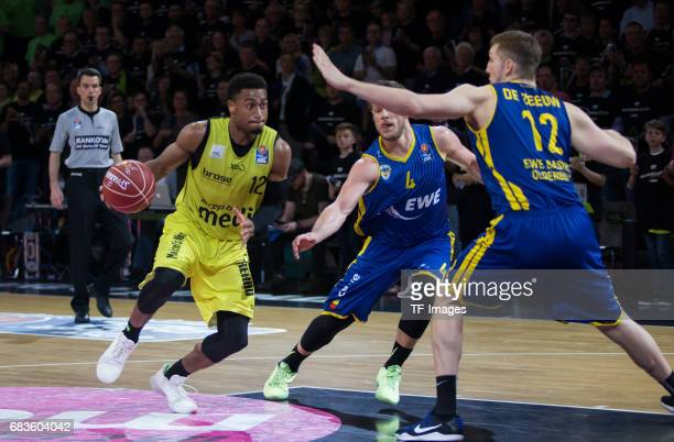 Lewis Trey of medi bayreuth Kramer Chris and De Zeeuw maxime of Oldenburg battle for the ball during the easyCredit BBL match between medi bayreuth...