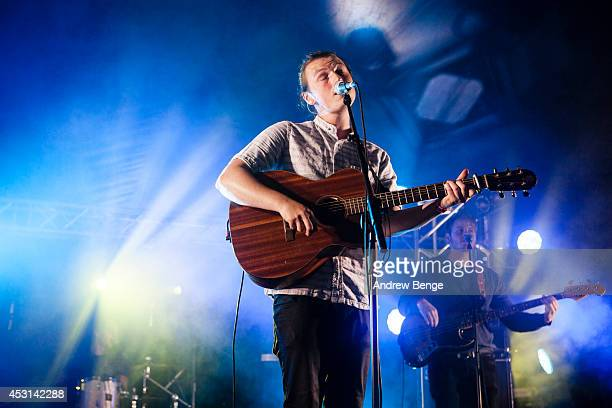 Lewis Watson performs on stage at Kendal Calling Festival at Lowther Deer Park on August 3 2014 in Kendal United Kingdom