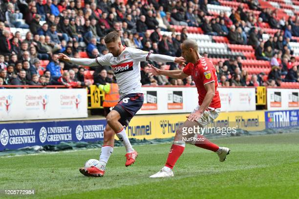 Lewis Wing and Darren Pratley in action during the Sky Bet Championship match between Charlton Athletic and Middlesbrough at The Valley London on...