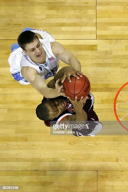 Lewis Witcher of the Virginia Tech Hokies grabs a rebound as Tyler Hansbrough of the North Carolina Tar Heels goes after it during the semifinals of...