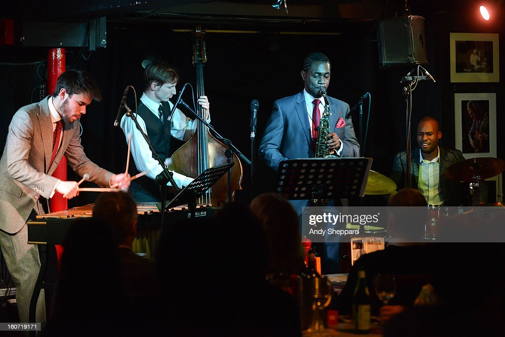 Lewis Wright, Tom Farmer, Nathaniel Facey and Shane Forbes of the band Empirical perform on stage at Pizza Express Jazz Club on February 4, 2013 in London, England.