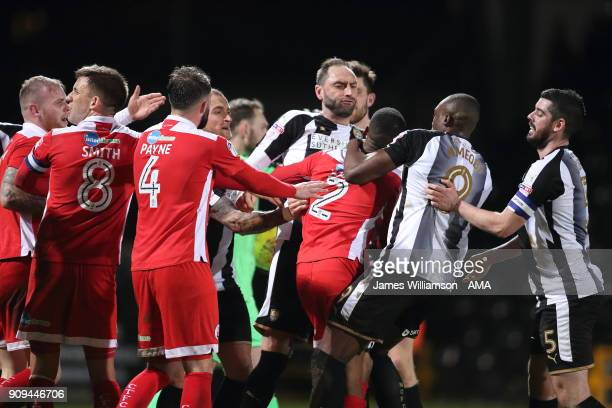 Lewis Young of Crawley Town gets into a confrontation with Nicky Hunt of Notts County and Shola Ameobi of Notts County during the Sky Bet League Two...