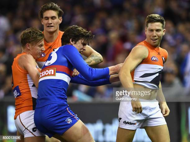 Lewis Young of the Bulldogs remonstrates with Toby Greene of the Giants after an incident with Luke Dahlhaus of the Bulldogs during the round 21 AFL...