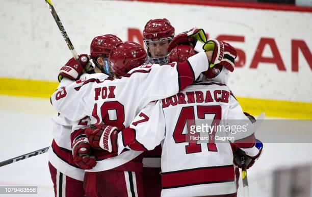 Lewis ZerterGossage of the Harvard Crimson celebrates his goal against the Boston University Terriers with teammate Jack Drury Adam Fox Reilly Walsh...