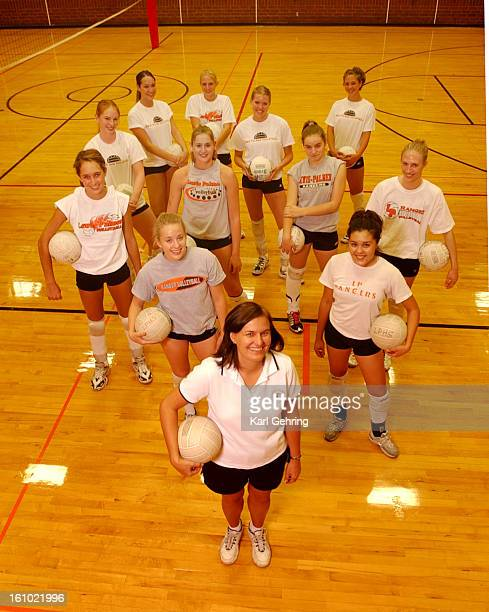 LewisPalmer High School volleyball coach Susan Odenbaugh <cq> front posed with the varsity squad Tuesday afternoon Team members from left are Jessica...