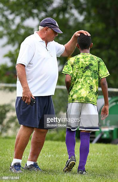 Lewiston High School soccer coach Mike McGraw says something encouraging to a freshman soccer player Aug 17 2016 Somali and other African refugees...