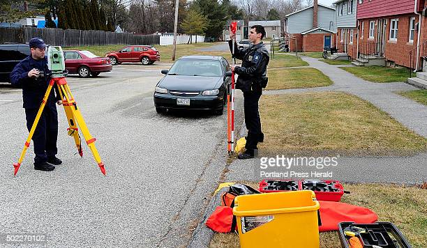 Lewiston police officers Jeremy Somma left and Travis Fecteau survey the area where a toddler was struck by a vehicle driven by his father on Rideout...