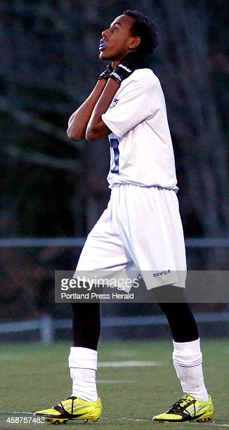 Lewiston's Abdi ShariffHassan reacts after his team couldn't convert on a scoring try late in the second half of a 21 loss to Cheverus in the Class A...