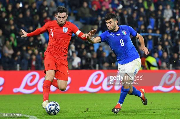 Lewwis Cook of England U21 competes for the ball with Parick Cutrone of Italy U21 during the International friendly match between Italy U21 and...