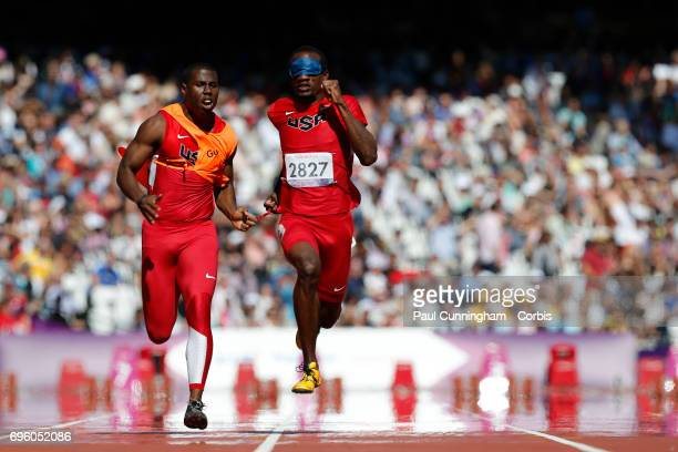 Lex Gillette with guide Wesley Williams running in the Men's 100m T11 Round 1 during day 9 of the London 2012 Paralympic Games at the Olympic Stadium...
