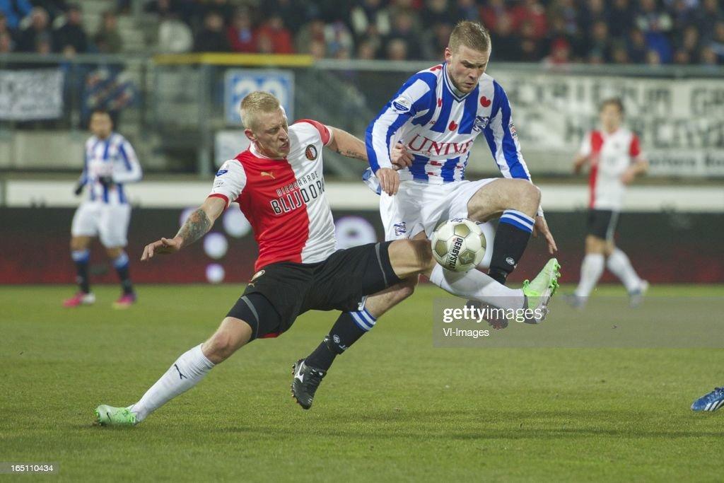 Lex Immers of Feyenoord, Joey van den Berg of SC Heerenveen during the Dutch Eredivisie match between SC Heerenveen and Feyenoord at the Abe Lenstra Stadium on march 30, 2013 in Heerenveen, The Netherlands