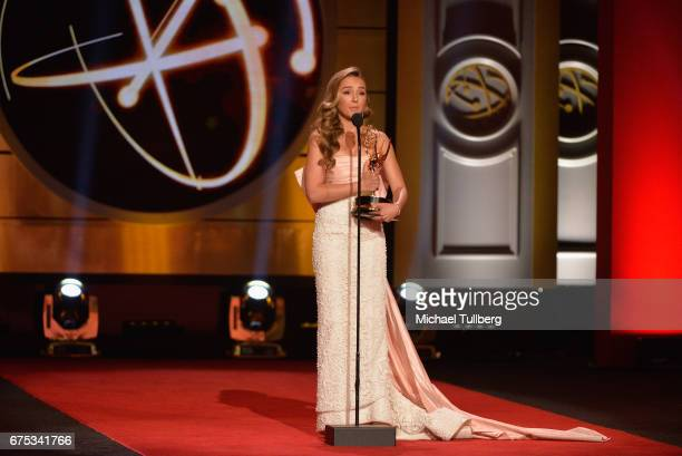 Lexi Ainsworth accepts the award for younger actress in a drama series for 'General Hospital' at the 44th annual Daytime Emmy Awards at Pasadena...